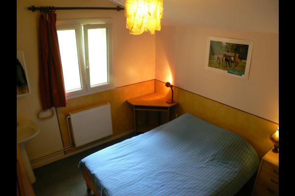 Chambre 1 lit 2 personnes - Location de vacances - Louvigny