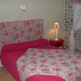 chambre rose - Chambre d'hôte - Fridefont