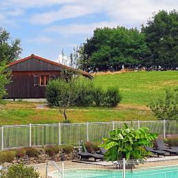 chalets en bois avec piscine chauffée - Location de vacances - Junhac