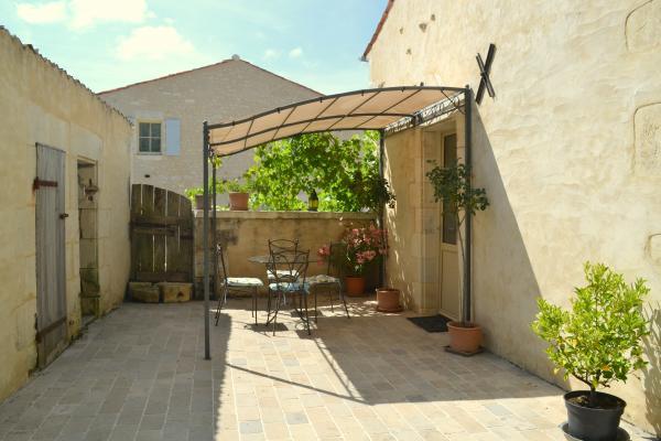 La terrasse sous la vigne - Location de vacances - Cabariot