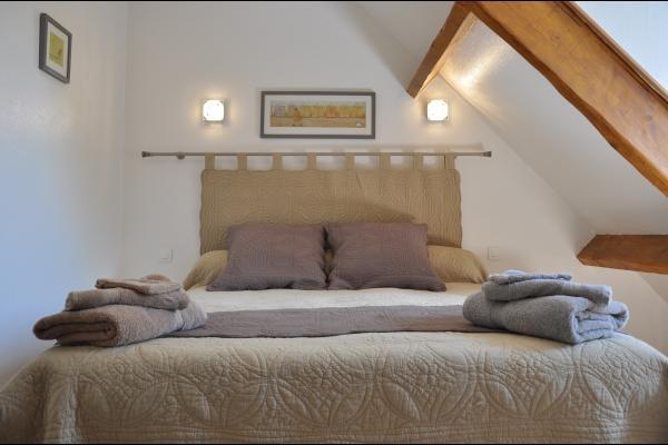 Chambre avec lit queen size - Location de vacances -