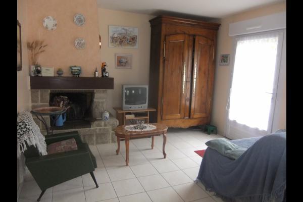Location - Maison de vacances - Plaintel - Salon avec cheminée - Location de vacances - Plaintel