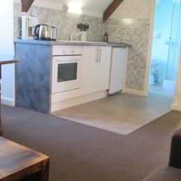 l'espace cuisine de la pièce de vie - Location de vacances - Paimpol
