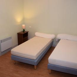 chambre 2 - Location de vacances - Singleyrac