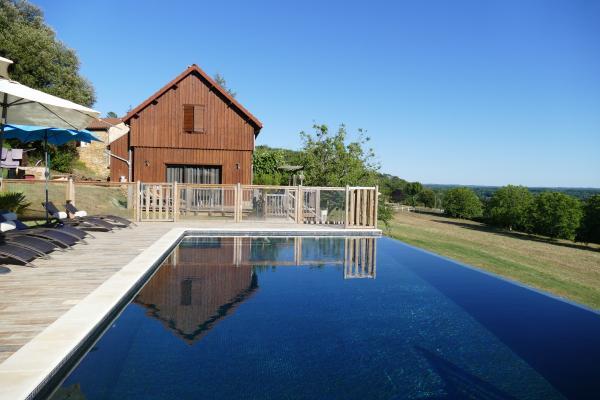 Ancien séchoir réhabilité en gîte de luxe avec piscine chauffée à débordement  - Location de vacances - Carsac-Aillac