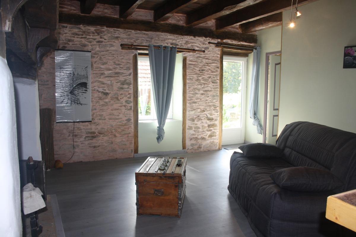 coin salon cheminée - Chambre d'hôtes - La Coquille