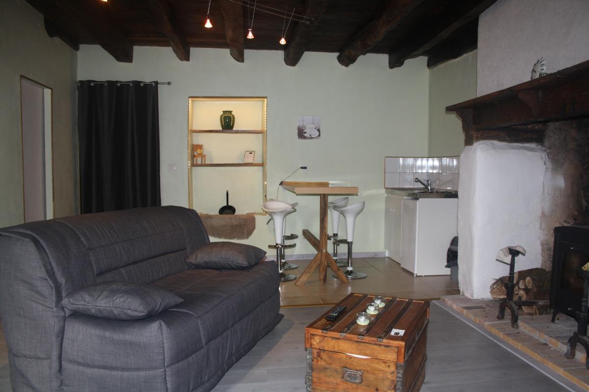 coin salon kitchenette - Chambre d'hôtes - La Coquille
