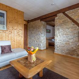 Salon avec pierres apparentes - Chambre d'hôtes - Fournet-Blancheroche