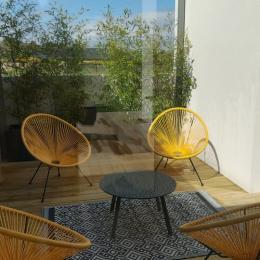 Extérieur de la maison avec salon de jardin et barbecue - Location de vacances - Saint-Pol-de-Léon