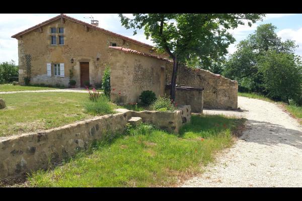Vue jardin et façade - Location de vacances - Cazaux-d'Anglès