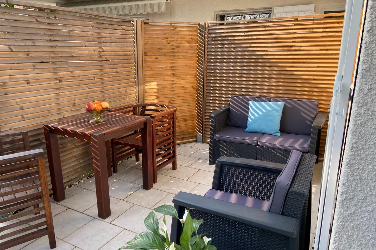 Terrasse et salon de jardin - Location de vacances - Andernos-les-Bains