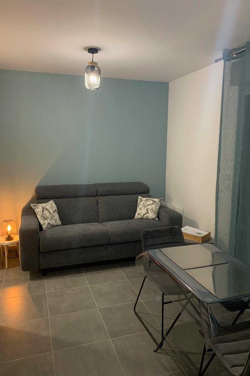 L'espace salon, canapé convertible - Studio Hermine Saint Malo - Location de vacances - Saint-Malo