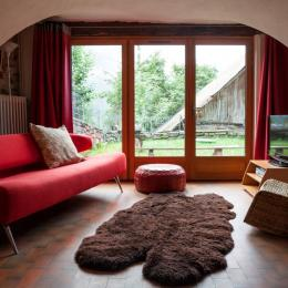 Chalet Les Farfelus à Vaujany-Massif des Grandes Rousses/Alpe d'Huez - Dedans dehors : salon et jardin - Location de vacances - Vaujany