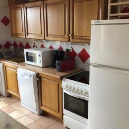 Cuisine équipée : frigo/congel, four, plaques électriques, lave / sèche linge - Location de vacances - Mont-de-Lans