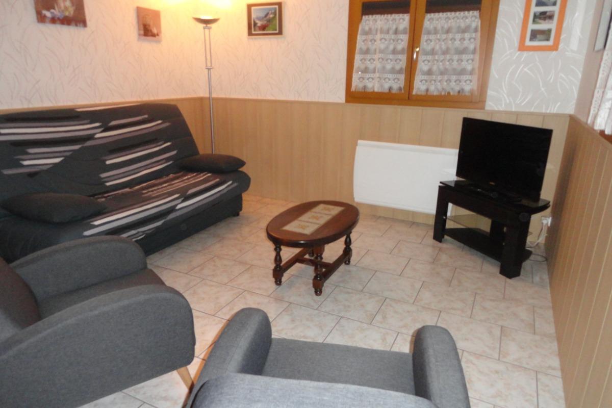 salon avec cheminée - Location de vacances - Les Rousses