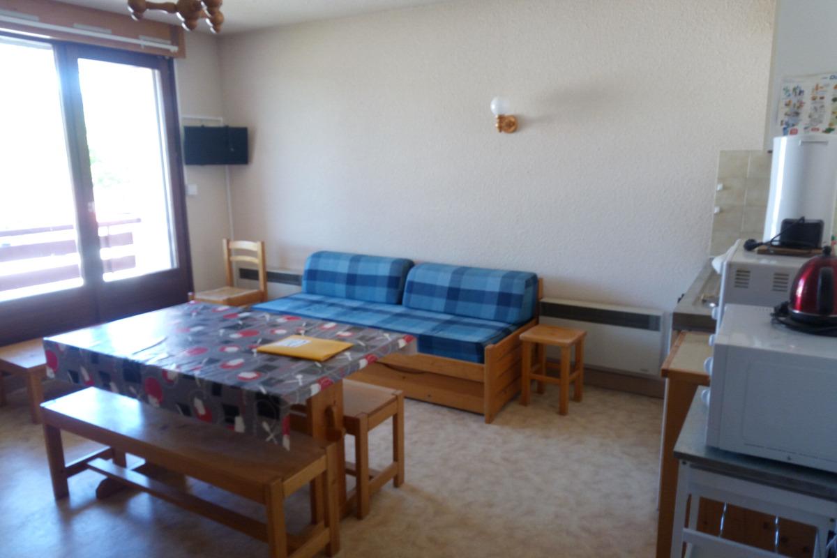 Coin séjour et salle à manger - Location de vacances - Bellefontaine