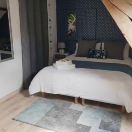 Une chambre nichée sous les toits - Chambre d'hôtes - Le Pin