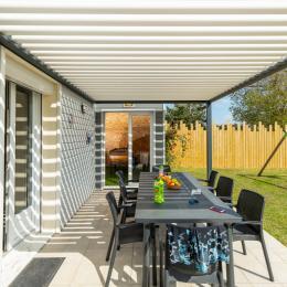 canapé, grand parasol, barbecue WEBER - Location de vacances - Denneville