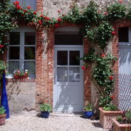 Petite cour fleurie espace extérieur - Location de vacances - Germaine