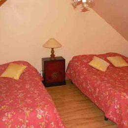 Chambre en mezzanine - Location de vacances - Les Fougerêts