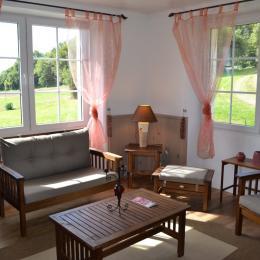 Le salon commun au rez de chaussée de la maison d'hôtes - Chambre d'hôtes - Ploërdut