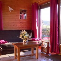 Salon/séjour - Chalet avec vue paradisiaque sur le Massif du Sancy - Location de vacances - Saint-Floret