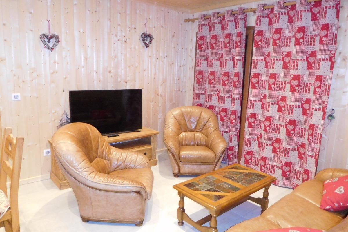 Appartement Le Lièvre Blanc - Chalet neuf à La Toussuire en Savoie - coin salon  - Location de vacances - La Toussuire