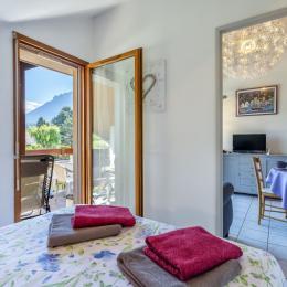 Chambre double, literie de qualité - Location de vacances - Saint-Jorioz