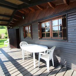 Terrasse 1 couverte - Chalet la Hutte Baret Vosges - Location de vacances - Raon-aux-Bois