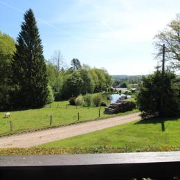 Terrasse devant le chalet - Chalet la Hutte Baret - Location de vacances - Raon-aux-Bois