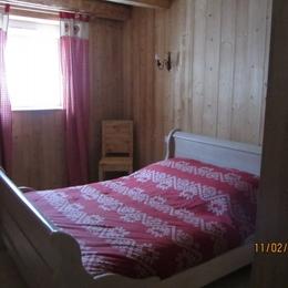 Chambre 1 grand lit double - Gite la Fermette Gérardmer - Location de vacances - Gérardmer