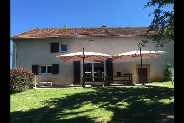 la façade arrière de la Maison de Solène - Location de vacances - Corcieux