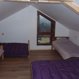 Chambre étage 4 pers - Location de vacances - Le Tholy