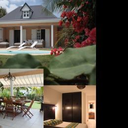 La terrasse face à la mer, le coin repas Barbecue, une chambre avec salle de bain - Location de vacances - Saint-François