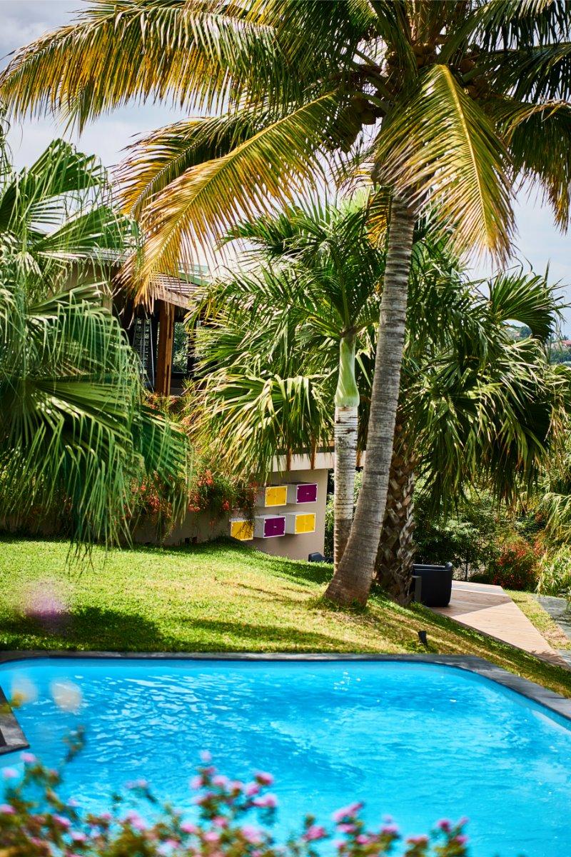vue piscine et bibliothèque - Chambre d'hôtes - L'Étang-Salé